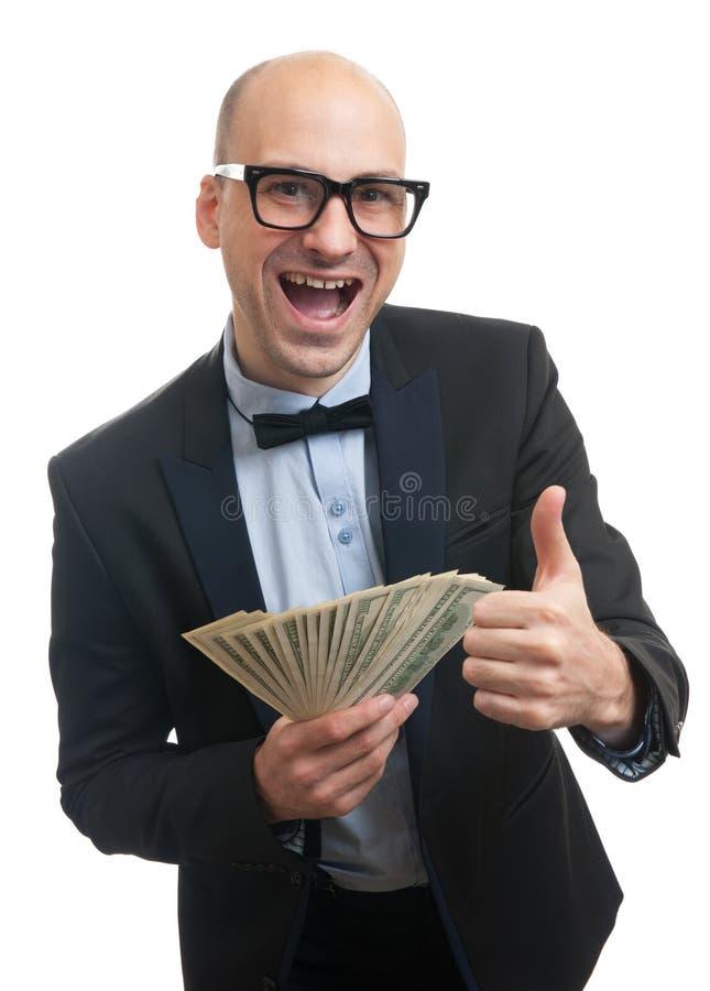 Szczęśliwy bogaty człowiek trzyma mnóstwo pieniądze obrazy stock