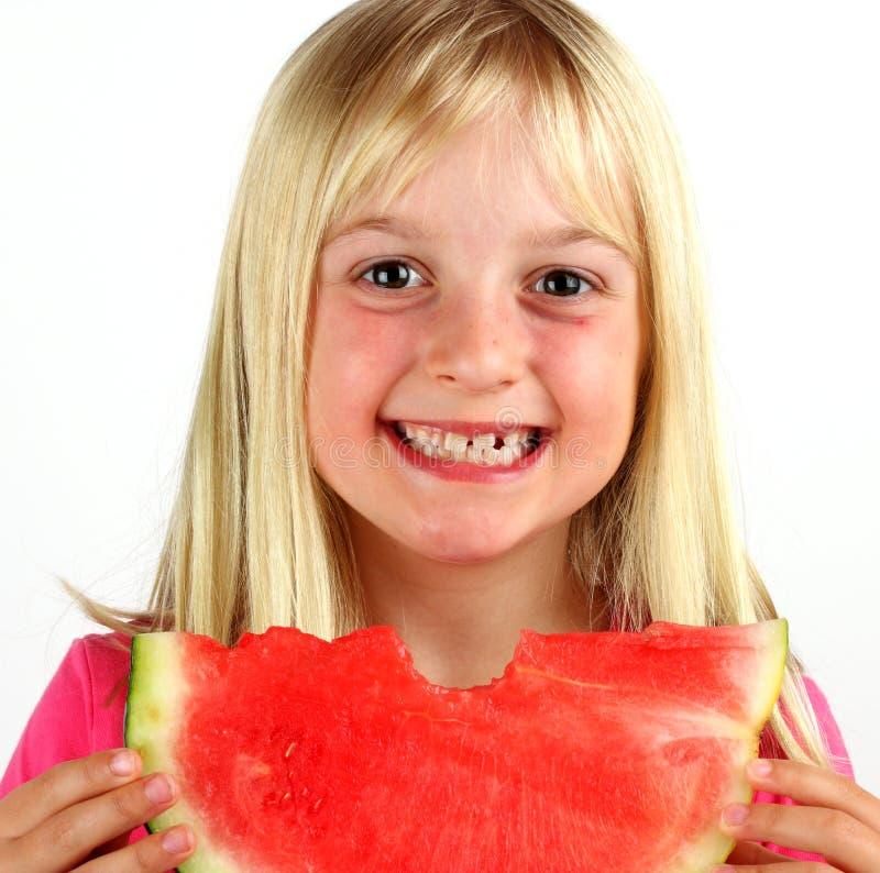 szczęśliwy canteloupe dzieciaku fotografia royalty free