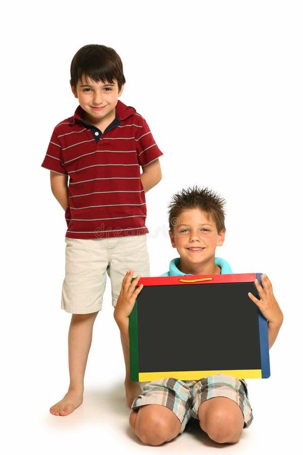szczęśliwy chłopiec chalkboard obrazy stock
