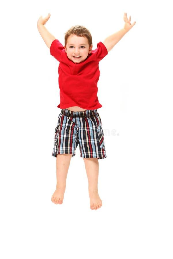 szczęśliwy chłopiec doskakiwanie zdjęcie royalty free