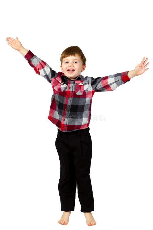 Szczęśliwy chłopiec doskakiwanie z rękami Up i Rozpostarty fotografia stock