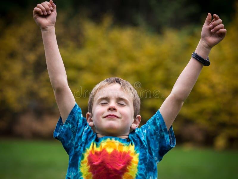 Szczęśliwy chłopiec sukces obraz stock