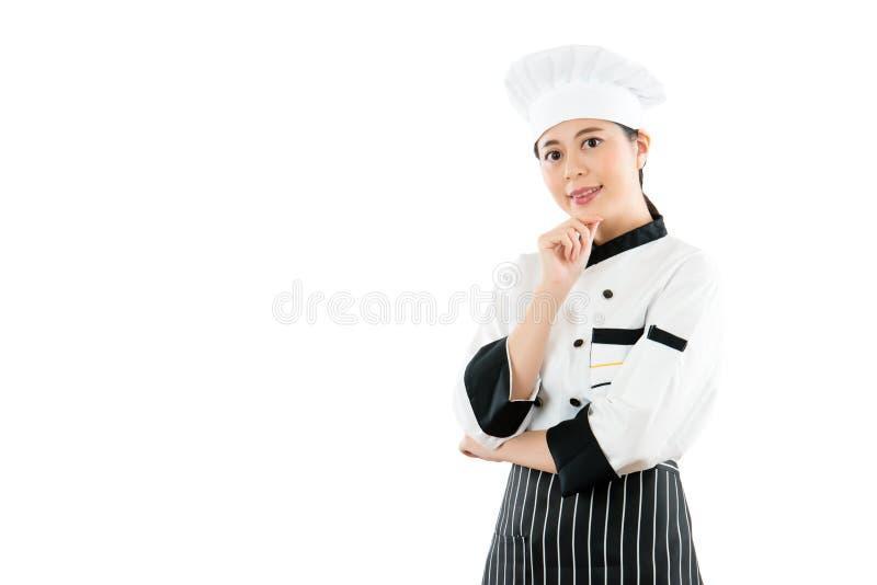 Szczęśliwy dumny kobieta w szefa kuchni mundurze obrazy stock