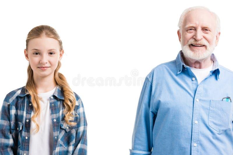 Szczęśliwy dziadu i wnuczki pozować fotografia stock