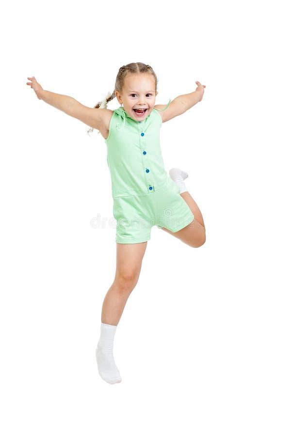 Szczęśliwy dziecko dziewczyny doskakiwanie odizolowywający na bielu zdjęcie stock