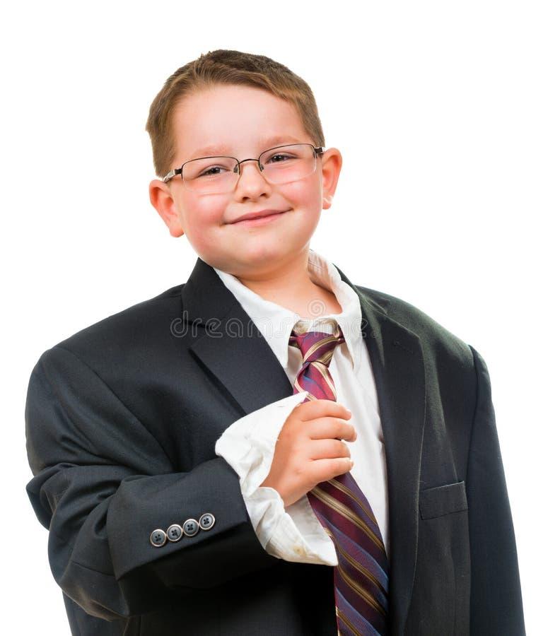 Szczęśliwy dziecko jest ubranym kostium który jest zbyt duży obraz stock