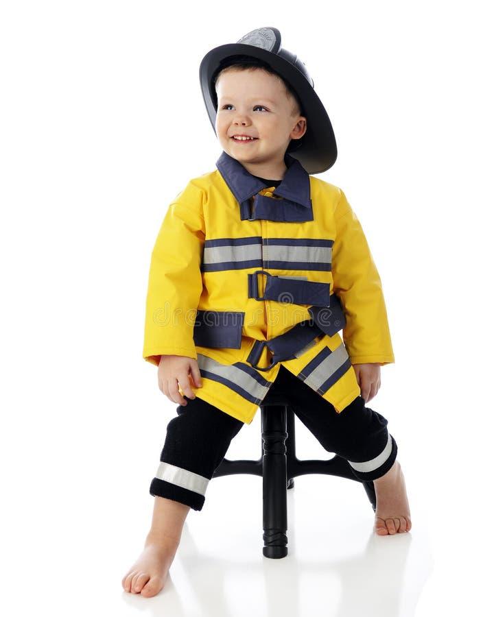 Szczęśliwy dziecko strażak fotografia royalty free