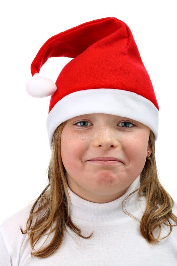 szczęśliwy dziewczyna kapelusz odizolowywał czerwień biel s Santa zdjęcia stock