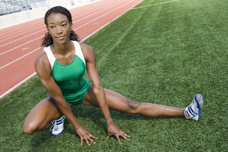 Szczęśliwy Żeńskiej atlety Rozgrzewkowy Up obraz stock
