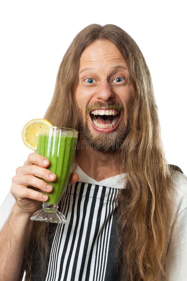 Szczęśliwy hipis pije zielonego jarzynowego smoothie fotografia royalty free
