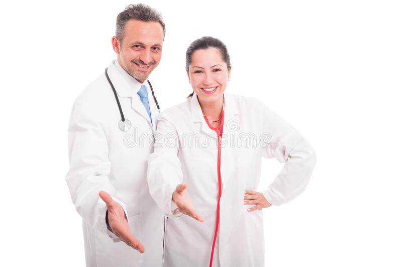 Szczęśliwy i pomyślny zaopatrzenie medyczne robi uścisku dłoni gestowi zdjęcie stock