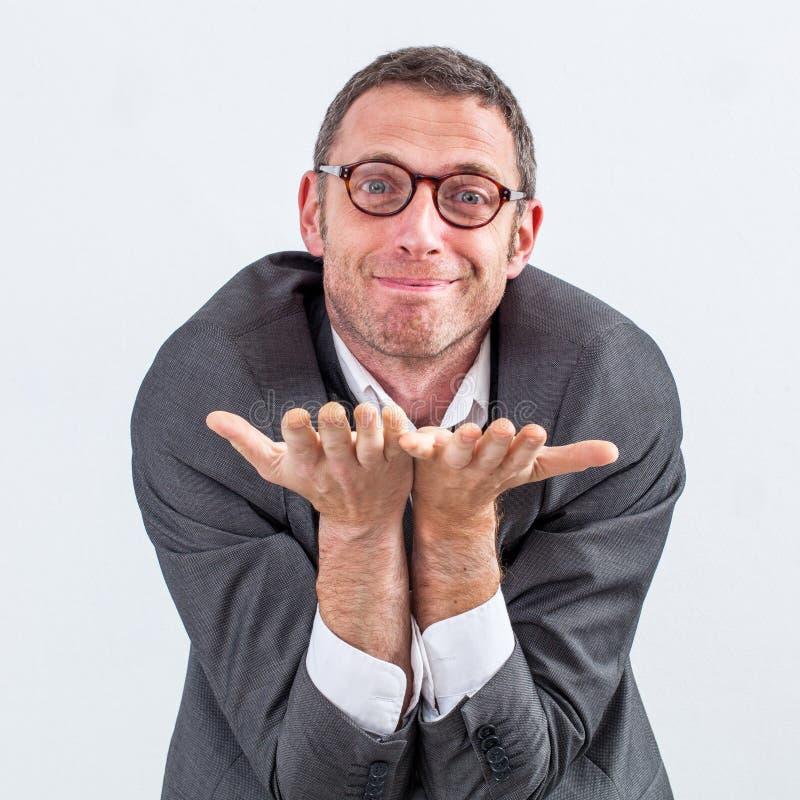 Szczęśliwy kierownik błaga coś dla lub oferuje dobroci lub hojności zdjęcie stock