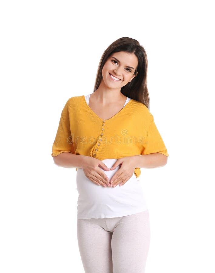 Szczęśliwy kobieta w ciąży pozować zdjęcie royalty free