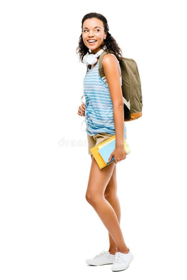 Szczęśliwy latynos mieszał biegowego kobieta ucznia iść z powrotem szkoła zdjęcia stock