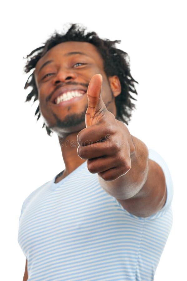 Szczęśliwy mężczyzna seans kciuk szczęśliwy obraz stock