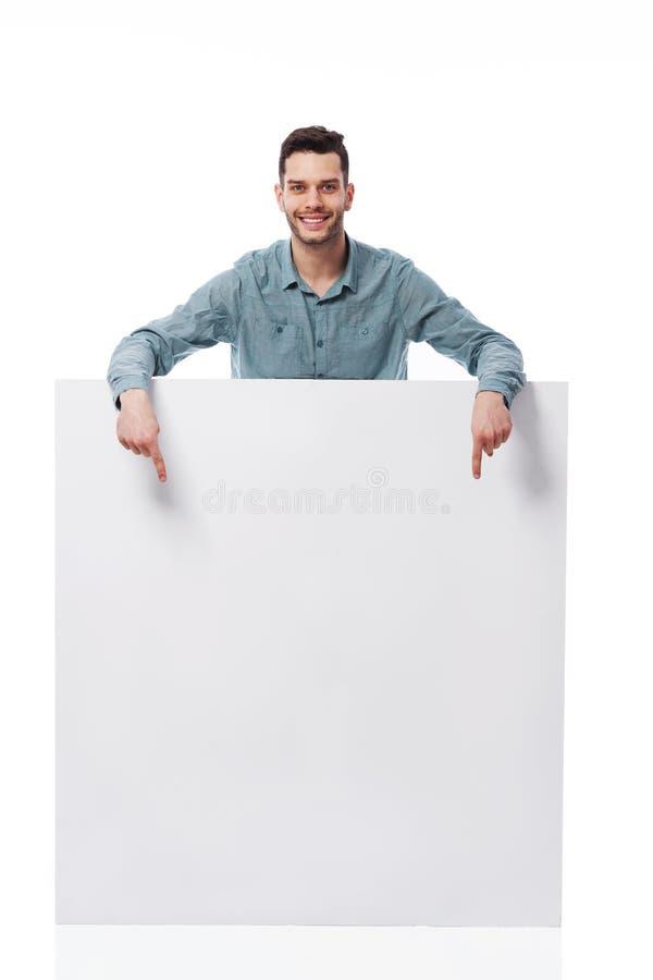 Szczęśliwy Mężczyzna Z Białą Deską Zdjęcie Stock