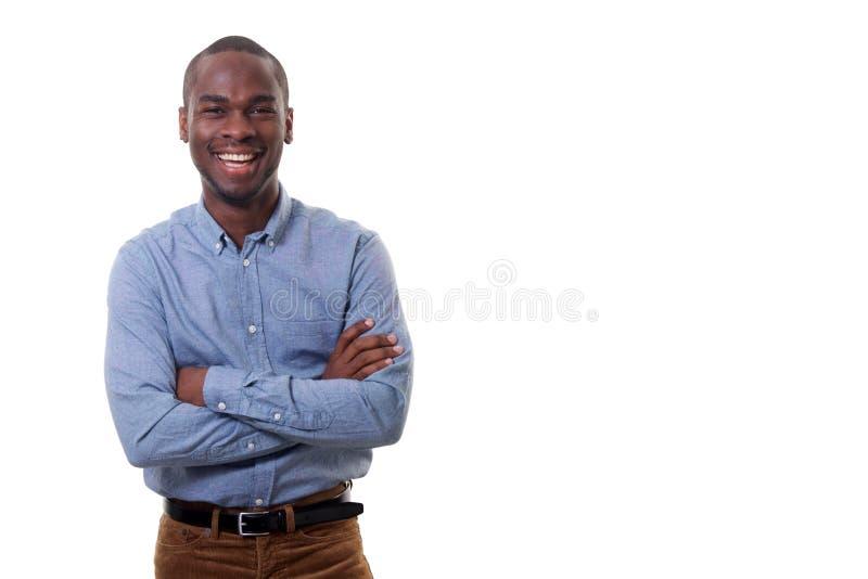 Szczęśliwy młody biznesmen ono uśmiecha się przeciw odosobnionemu białemu tłu zdjęcia stock