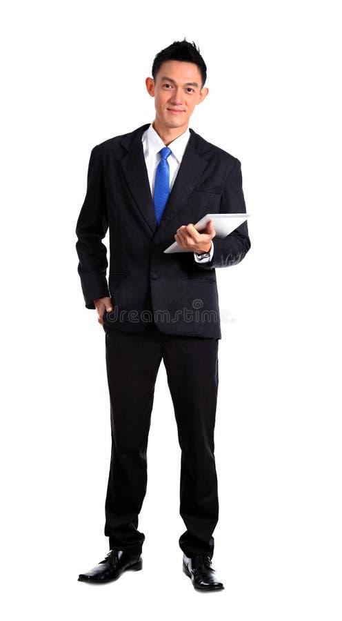 Szczęśliwy Młody biznesmen Używa Cyfrowej pastylkę Odizolowywa zdjęcie stock