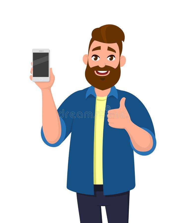 Szczęśliwy młody człowiek pokazuje smartphone i pokazuje aprobaty jak znak lub ilustracji