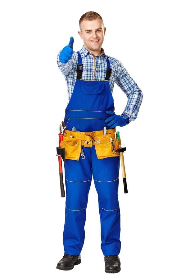 Szczęśliwy młody pracownik budowlany fotografia royalty free