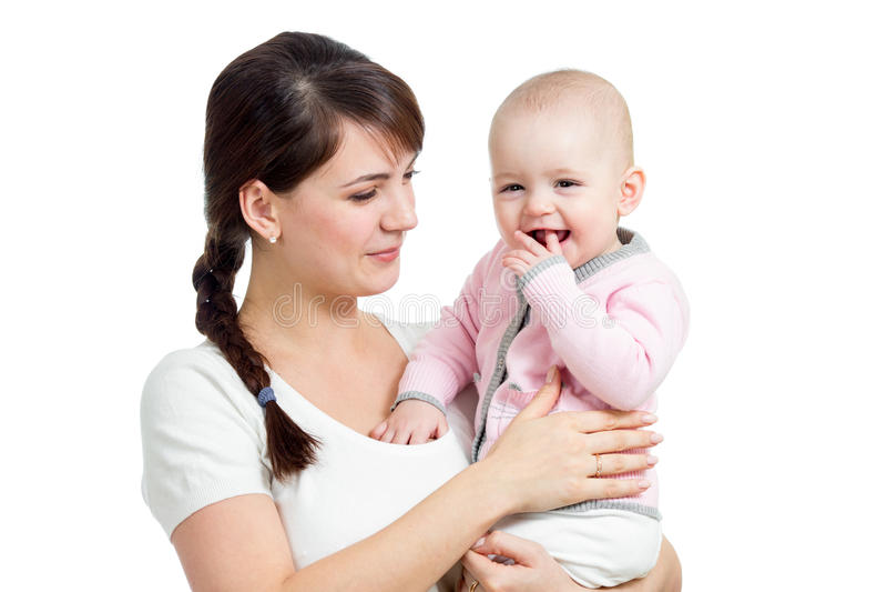 Szczęśliwy macierzysty patrzejący jej dziewczynki odizolowywającej zdjęcie royalty free