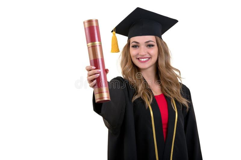Szczęśliwy magistrant/magistrantka mienie dyplom odizolowywający na białym tle zdjęcie royalty free
