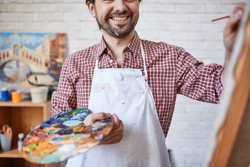 Download Szczęśliwy malarz zdjęcie stock. Obraz złożonej z potomstwa - 53777456