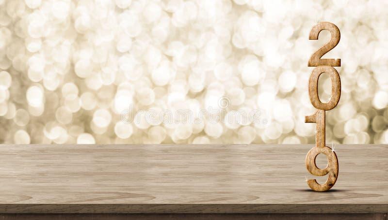 Szczęśliwy nowego roku 2019 drewno z lśnienie gwiazdą na brown drewno stole obraz royalty free