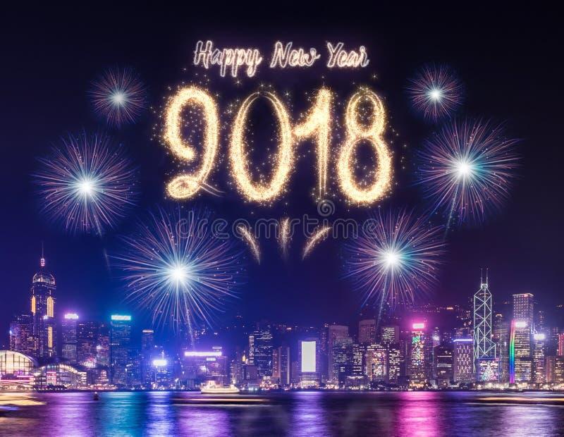 Szczęśliwy nowego roku 2018 fajerwerk nad pejzażem miejskim buduje blisko morza przy fotografia royalty free