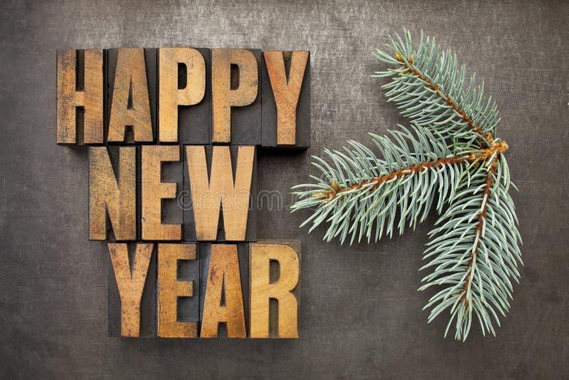 Szczęśliwy nowy rok w drewnianym typ obraz royalty free