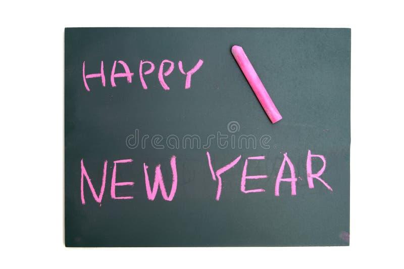 Szczęśliwy nowy rok z czerwieni kredą na blackboard obraz stock