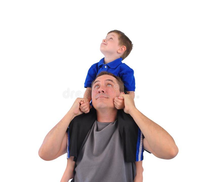Szczęśliwy ojciec i syn na bielu Wpólnie fotografia royalty free
