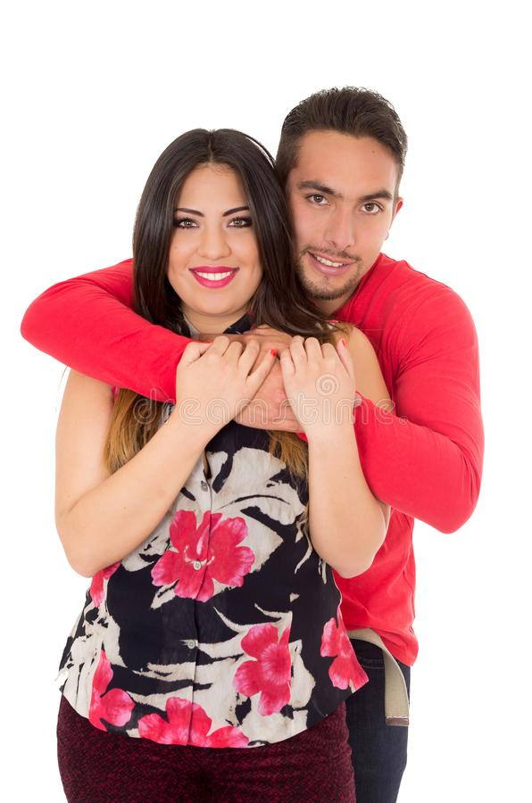 Szczęśliwy pary obejmowanie i przyglądająca kamera na białym tle zdjęcia stock