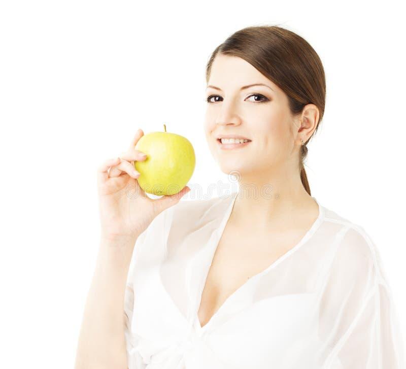 Szczęśliwy piękny kobiety mienia zieleni jabłko obraz stock