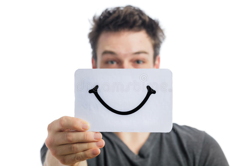 Szczęśliwy portret Someone Trzyma Uśmiechniętą nastrój deskę obraz stock