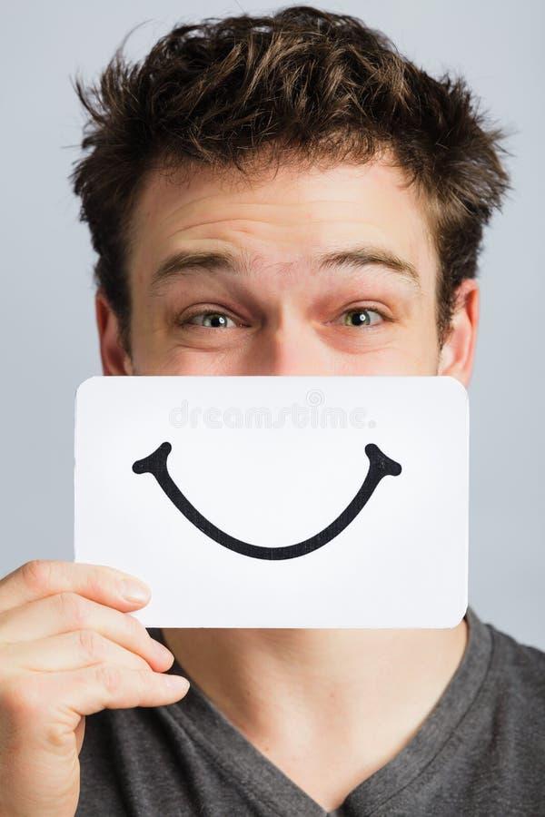 Szczęśliwy portret Someone Trzyma Uśmiechniętą nastrój deskę zdjęcia royalty free