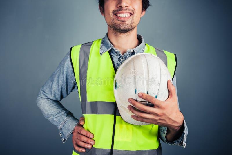 Szczęśliwy potomstwo inżynier z ciężkim kapeluszem fotografia royalty free