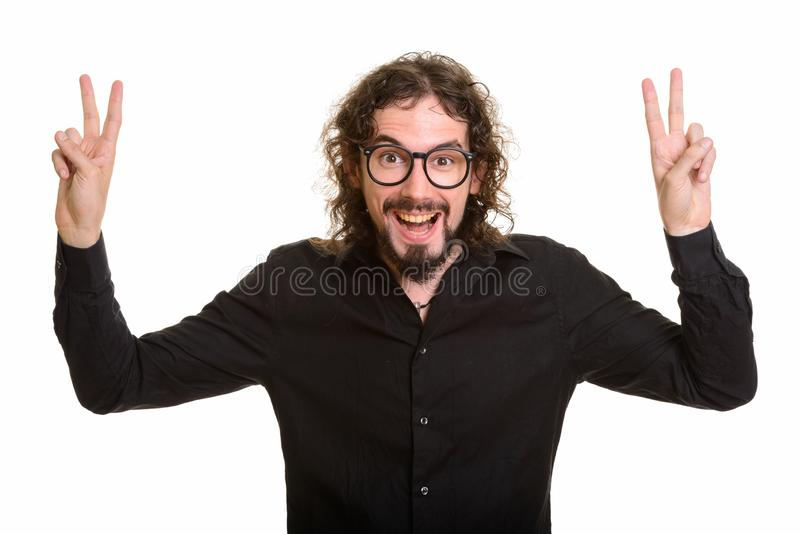 Szczęśliwy przystojny Kaukaski mężczyzna daje pokoju znakowi z oba rękami obrazy stock