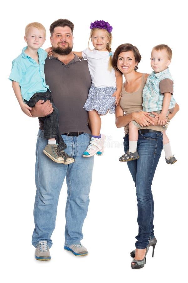 Szczęśliwy rodzinny portret ono uśmiecha się wpólnie zdjęcia royalty free