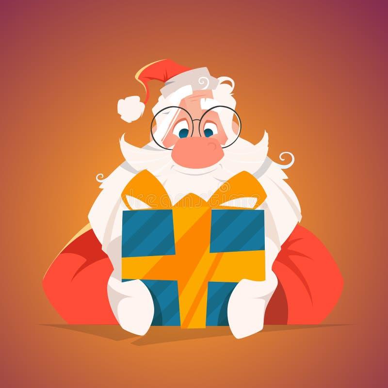 Szczęśliwy Santa trzyma prezenta pudełko zdjęcie royalty free