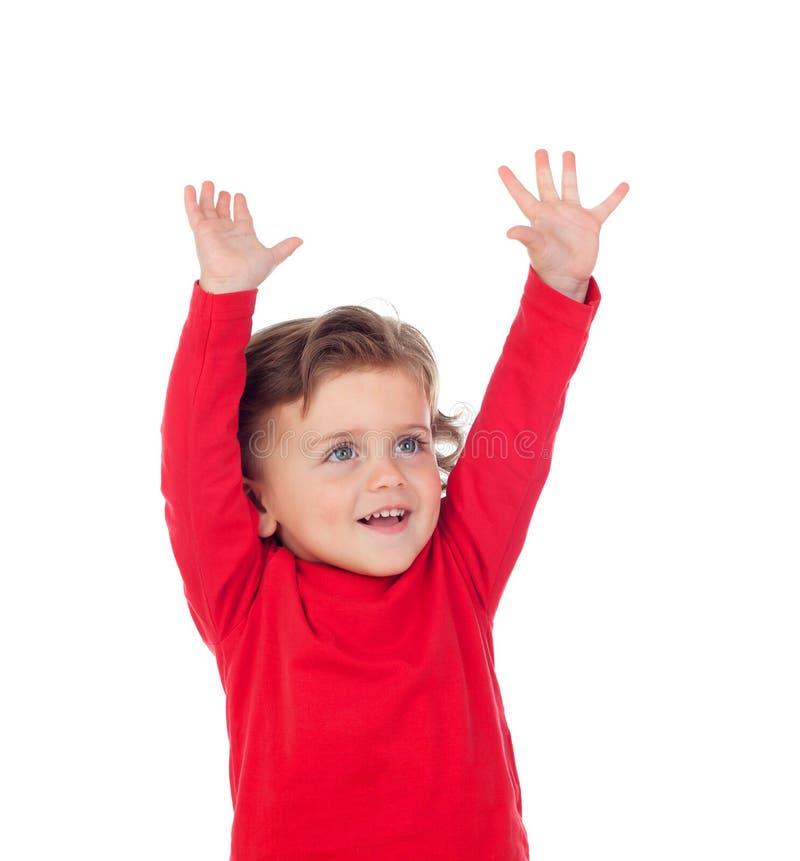 Szczęśliwy sukcesu dziecko podnosi jego ręki obraz stock
