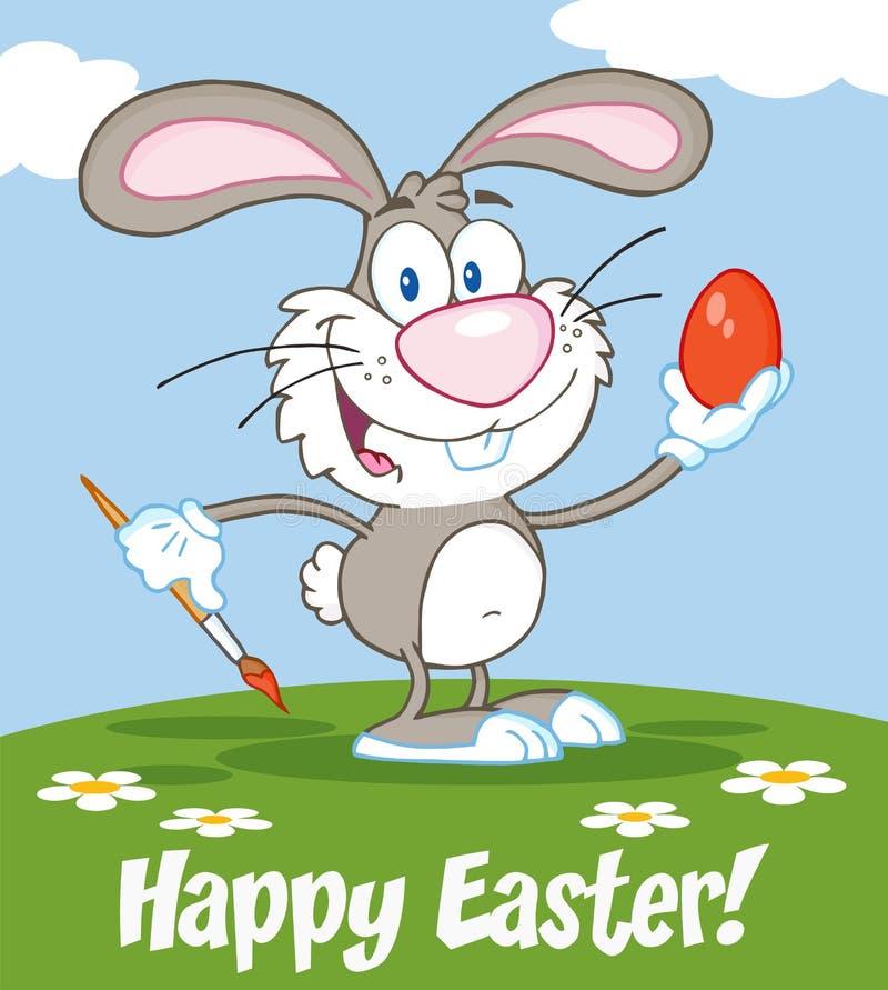 Szczęśliwy Szary królik Maluje Wielkanocnego jajko ilustracja wektor