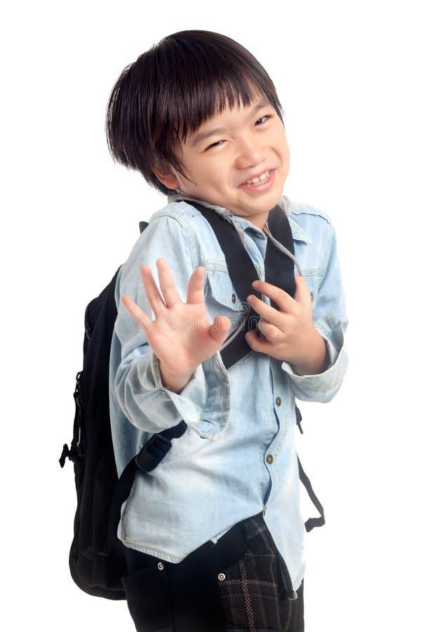 Szczęśliwy szkolny dzieciaka śmiać się zdjęcie stock