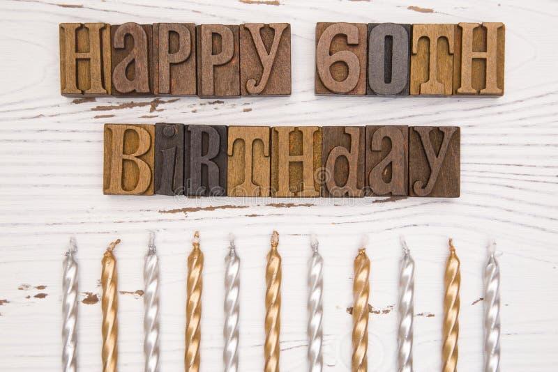 Szczęśliwy 60th urodziny Literujący w typ set fotografia royalty free