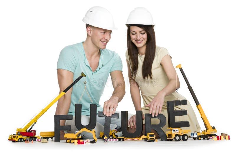 Szczęśliwy uśmiechnięty mężczyzna i kobieta buduje w górę ich przyszłości. zdjęcie stock