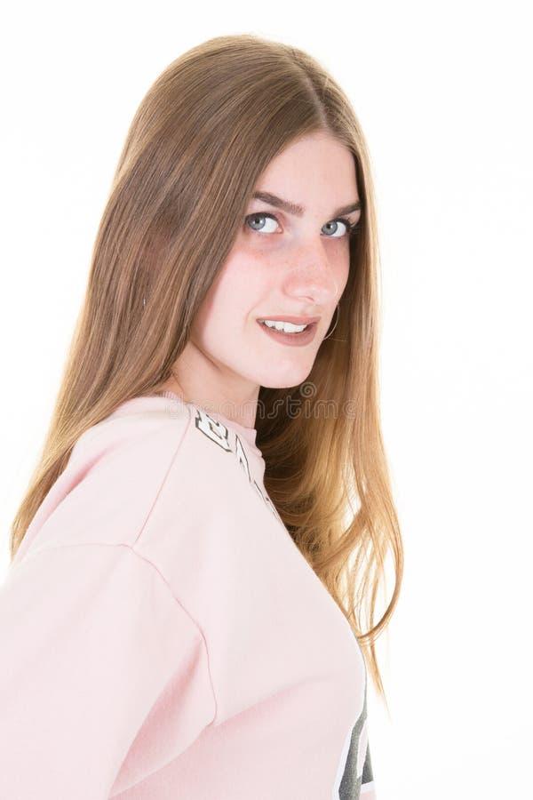 Szczęśliwy uśmiechnięty nastoletnia dziewczyna uczeń odizolowywający na białym backgroud obraz royalty free