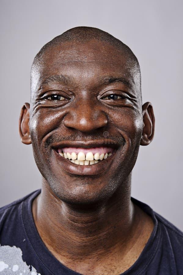 Szczęśliwy uśmiechnięty portret zdjęcia stock
