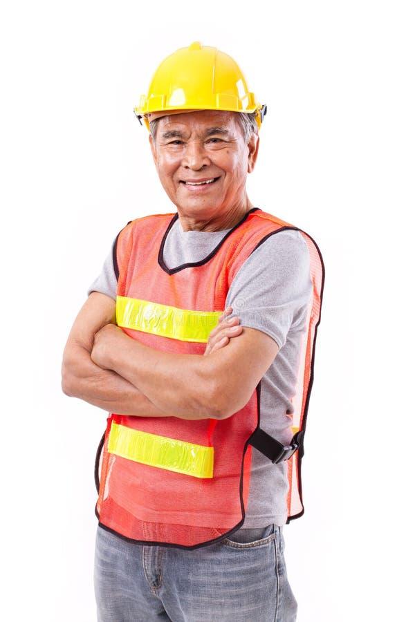 Szczęśliwy, uśmiechnięty starszy pracownik budowlany, lub inżynier obraz royalty free