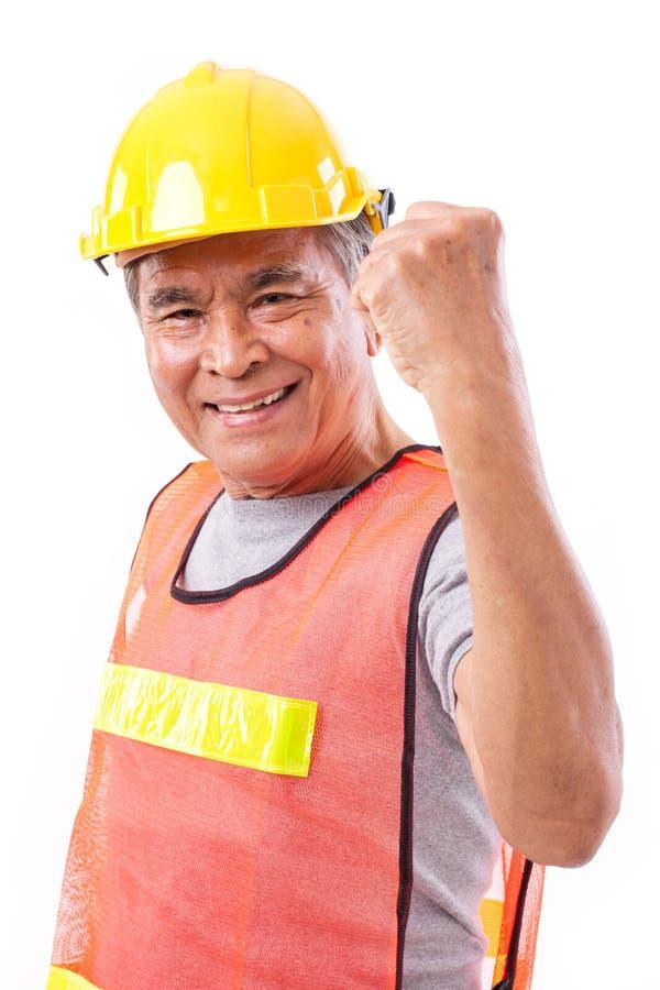 Szczęśliwy, uśmiechnięty starszy pracownik budowlany, lub inżynier zdjęcie royalty free
