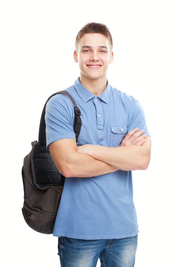 Szczęśliwy uśmiechnięty uczeń z plecakiem odizolowywającym na wh obrazy royalty free